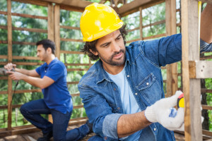 Male Carpenters Working At Construction Site